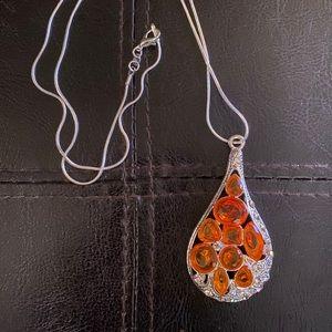 Big drop pendant with orange crystals